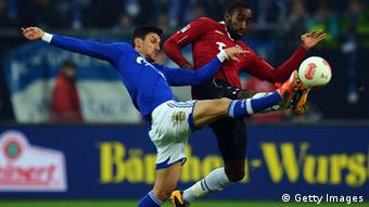 Ciprian Marica of Schalke is challenged by Johan Djourou of Hannover during the Bundesliga match between FC Schalke 04 and Hannover 96 at Veltins-Arena on January 18, 2013 in Gelsenkirchen, Germany. (Photo by Lars Baron/Bongarts/Getty Images)