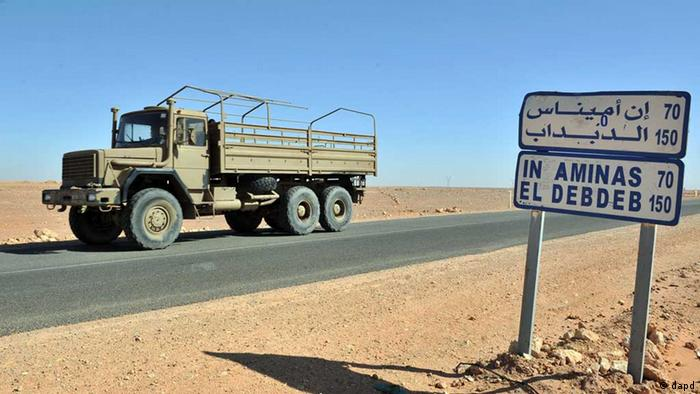 An Algerian military truck drives past a road sign indicating the city of In Amenas where hostages have been kidnapped by islamic militants at a gas plant (Photo: Anis Belghoul/AP/dapd)