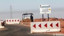 An Algerian soldier is seen at a checkpoint near the road, 10 km to the Tiguentourine gas plant, where Islamist militants have been holding foreigners hostage, January 19, 2013. More than 20 foreigners were captive or missing inside a desert gas plant on Saturday, nearly two days after the Algerian army launched an assault to free them that saw many hostages killed. The standoff between the army and al Qaeda-linked gunmen - one of the biggest international hostage crises in decades - entered its fourth day, having thrust Saharan militancy to the top of the global agenda. REUTERS/Louafi Larbi (ALGERIA - Tags: CIVIL UNREST POLITICS ENERGY)
