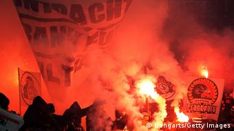 Fans of Frankfurt burn flares and throw firework during the Bundesliga match between Bayer 04 Leverkusen and Eintracht Frankfurt at BayArena on January 19, 2013 in Leverkusen, Germany. (Photo by Lars Baron/Bongarts/Getty Images)