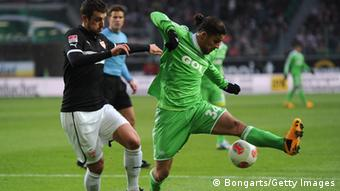 Ricardo Rodriguez of Wolfsburg is challenged byZdravko Kuzmanovic of Stuttgart during the Bundesliga match between VfL Wolfsburg and VfB Stuttgart at Volkswagen Arena on January 19, 2013 in Wolfsburg, Germany. Photo by Stuart Franklin/Bongarts/Getty Images