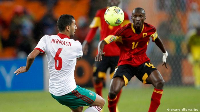 epa03544920 Morocco's Adil Hermach (L) vies for the ball with Angola's Jose Panzo (R) during the preliminary round match at the Africa Cup of Nations between Angola and Morocco at Soccer City in Johannesburg, South Africa, 19 January 2013. EPA/KIM LUDBROOK