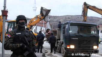 GettyImages 159760890 A Serbian gendarme secures the area during removing of the monument of the Liberation Army of Presevo, Medvedja and Bujanovac (UCPMB) in the town of Presevo on January 20, 2013. Serbian authorties removed early in the morning the monument eracted in the ethnic Albanian stronghold town of Presevo and dedicated to the fighters in the 2001 conflict against Serbian security forces. The monument, dedicated to the fallen members of the Liberation Army for Presevo, Medvedja and Bujanovac, whose goal was to unite the ethnic Albanian majority area in the Presevo Valley with neighbouring Kosovo, was erected in November in front of the ethnic-Albanian-run municipality building in Presevo. AFP PHOTO / SASA DJORDJEVIC (Photo credit should read SASA DJORDJEVIC/AFP/Getty Images)
