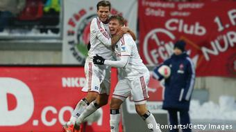 GettyImages 159767361 NUREMBERG, GERMANY - Artjoms Rudnevs (R) of Hamburg celebrates his team's first goal with team mate Dennis Diekmeier during the Bundesliga match between 1. FC Nuernberg and Hamburger SV at Easy Credit Stadium on January 20, 2013 in Nuremberg, Germany. (Photo by Alex Grimm/Bongarts/Getty Images)