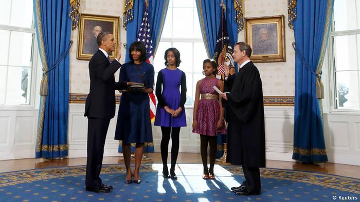U.S President Barack Obama (L) takes the oath of office from U.S. Supreme Court Chief Justice John Roberts (R) as first lady Michelle Obama holds the bible and daughters Malia (3rd-L) and Sasha look on in the Blue Room of the White House in Washington, January 20, 2013. REUTERS/Larry Downing (UNITED STATES - Tags: POLITICS)