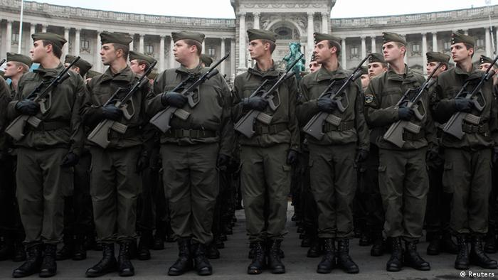 Austrian army recruits parade in front of historic Hofburg Palace during Austrian National Day celebrations in Vienna. Picture taken October 26, 2012. REUTERS/Heinz-Peter Bader/files (AUSTRIA - Tags: POLITICS)