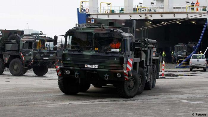 German military vehicles carrying equipment for NATO patriot defence missiles disembark at Turkey's Mediterranean port of Iskenderun in Hatay province January 21, 2013. A contingent of German Patriot missile units arrived at the Turkish port of Iskenderun on Monday after a two-week voyage. Germany shipped out the patriots as part of a NATO operation to bolster Turkey's defence against a threat of air attacks from Syria. REUTERS/Umit Bektas (TURKEY - Tags: POLITICS MILITARY)