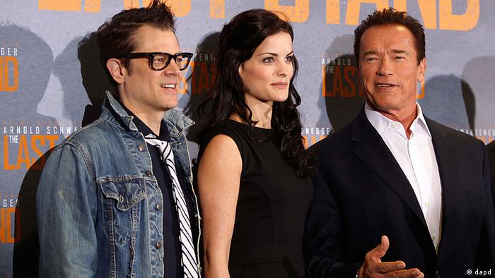 Actors Johnny Knoxville (left.), Jaimie Alexander (center) und Arnold Schwarzenegger at a press conference in Cologne for their recent film, The Last Stand