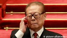 epa03469935 Chinese former president Jiang Zemin gestures during the closing ceremony of the 18th CPC (Communist Party Congress) in Beijing, China, 14 November 2012. The CPC is expected to introduce the new leadership lineup and the Standing Committee of the Politburo on 15 November, a day after the closing. EPA/HOW HWEE YOUNG
