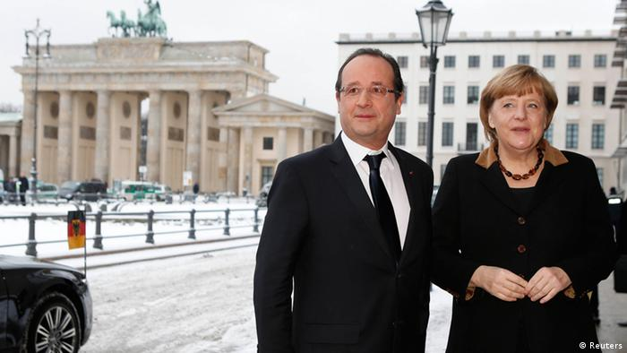German Chancellor Angela Merkel welcomes French President Francois Hollande outside the French embassy in Berlin January 22, 2013, during a day of celebrations marking the 50th Anniversary of the Elysee Treaty. REUTERS/Fabrizio Bensch (GERMANY - Tags: POLITICS)