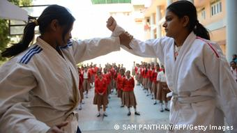 Indian female high school students watch an exhibition of basic Judo skills as they participate in a camp for self defense in Ahmedabad on January 21, 2013. (Photo: SAM PANTHAKY/AFP/Getty Images)