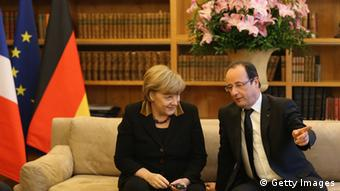GettyImages 159865778 BERLIN, GERMANY - JANUARY 22: German Chancellor Angela Merkel and French President Francois Hollande attend a reception for French and German cultural representatives at the French Embassy during the 50th anniversary celebration of the Elysee Treaty on January 22, 2013 in Berlin, Germany. The treaty, concluded in 1963 by Charles de Gaulle and Konrad Adenauer in the Elysee Palace in Paris, set a new tone of reconciliation between France and Germany, and called for consultations between the two countries to come to a common stance on policies affecting the most important partners in Europe as well as the rest of the region. Since its establishment, the document for improved bilateral relations has been seen by many as the driving force behind European integration. (Photo by Sean Gallup/Getty Images)