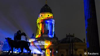 A projection illuminates the German Cathedral in the Gendarmenmarkt square in Berlin marking the 50th Anniversary of the Elysee Treaty, January 21, 2013. The writings reads, 50 years of the Elysee Treaty. REUTERS/Thomas Peter (GERMANY - Tags: POLITICS ANNIVERSARY SOCIETY)