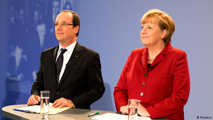 German Chancellor Angela Merkel and French President Francois Hollande speak during a meeting with some 200 German and French students and pupils as part of celebrations of the 50th anniversary of the Elysee Treaty, in the Chancellery in Berlin, January 21, 2013. (Photo: REUTERS/Kay Nietfeld/Pool)