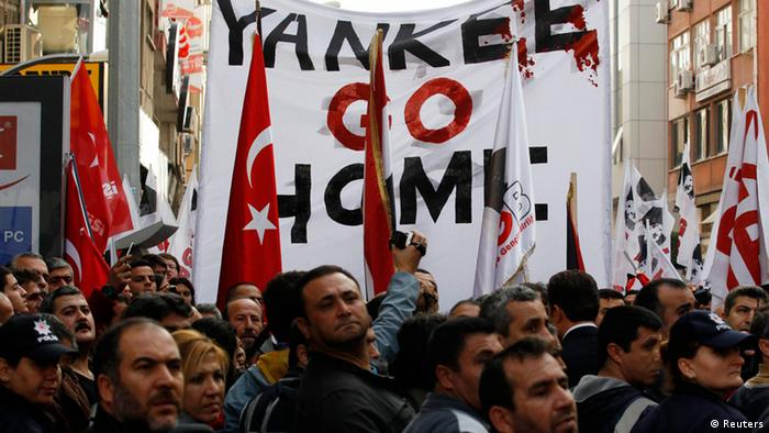 Turkish leftists and nationalists protest against the deployment of Patriot missiles in Turkey near the Mediterranean port of Iskenderun in Hatay province January 21, 2013. The first of six NATO Patriot missile batteries intended to protect Turkey from a potential Syrian attack arrived by ship from Germany on Monday, drawing a small but noisy protest from nationalist and leftist demonstrators. REUTERS/Umit Bektas (TURKEY - Tags: POLITICS CIVIL UNREST MILITARY)
