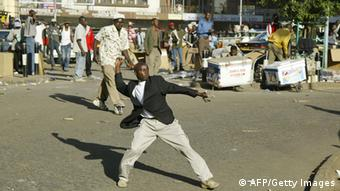 A stone-throwing youth in Nairobi shortly after the 2007 elections (Photo TONY KARUMBA/AFP/Getty Images)