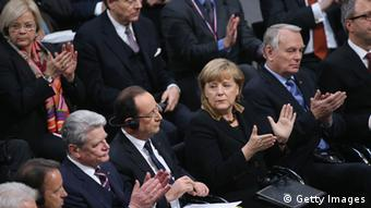 GettyImages 159874070 BERLIN, GERMANY - JANUARY 22: Members of the German Bundestag and French Assemble Nationale, including German Chancellor Angela Merkel and French President Francois Hollande (C), as well as German President Joachim Gauck (L) and French Prime Minister Jean-marc Ayrault, attend a joint session of the two governments at the Bundestag during the 50th anniversary celebration of the Elysee Treaty on January 22, 2013 in Berlin, Germany. The treaty, concluded in 1963 by Charles de Gaulle and Konrad Adenauer in the Elysee Palace in Paris, set a new tone of reconciliation between France and Germany, and called for consultations between the two countries to come to a common stance on policies affecting the most important partners in Europe as well as the rest of the region. Since its establishment, the document for improved bilateral relations has been seen by many as the driving force behind European integration. (Photo by Sean Gallup/Getty Images)