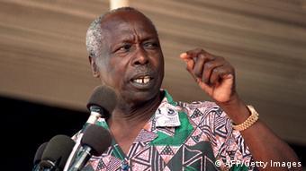 Daniel arap Moi at a microphone (Photo: ALEXANDER JOE/AFP/Getty Images)