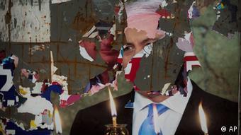 A torn poster of Israeli Prime Minister Benjamin Netanyahu is seen in on a wall in Jerusalem, Tuesday, Jan. 22, 2013. Photo:Sebastian Scheiner/AP/dapd