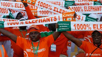 Ivory Coast supporters hold up team scarves ahead of their team's African Nations Cup (AFCON 2013) Group D soccer match against Togo in Rustenburg, January 22, 2013. REUTERS/Mike Hutchings (SOUTH AFRICA - Tags: SPORT SOCCER)