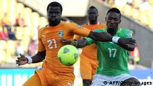 Ivory Coast's defender Emmanuel Eboue vies with Togo's forward Serge Gakpe during the 2013 African Cup of Nation in Rustenburg on January 22, 2013 at Royal Bafokeng Stadium in a Group D match. AFP PHOTO / ALEXANDER JOE (Photo credit should read ALEXANDER JOE/AFP/Getty Images)