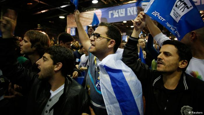 Supporters of Prime Minister Benjamin Netanyahu's Likud party celebrate after the exit polls were announced at the party's headquarters in Tel Aviv January 22, 2013. Exit polls in Israel on Tuesday showed a bloc of right-wing parties winning between 61 and 62 seats in the country's 120-member parliament, potentially enough for a governing majority. REUTERS/Baz Ratner (ISRAEL - Tags: POLITICS ELECTIONS)