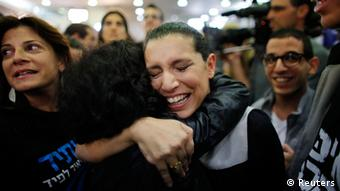 Supporters of Yair Lapid's Yesh Atid party celebrate after the exit polls were announced at the party's headquarters in Tel Aviv. (Ammar Awad/REUTERS)