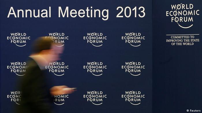 A man walks past the logo of the World Economic Forum (WEF) inside the Congress Hall at the Swiss Alpine resort of Davos January 22, 2013. The annual World Economic Forum held from January 23 to 27, 2013 in Davos. REUTERS/Pascal Lauener