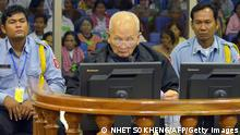 ----EDITORS NOTE---- RESTRICTED TO EDITORIAL USE MANDATORY CREDIT AFP PHOTO / NHET SOKHENG / ECCC NO MARKETING NO ADVERTISING CAMPAIGNS - DISTRIBUTED AS A SERVICE TO CLIENTS This handout photo taken and released by the Extraordinary Chamber in the Courts of Cambodia (ECCC) on December 13, 2011 shows former Khmer Rouge leader Brother Number Two Nuon Chea (C) sitting in a dock of the courtroom in Phnom Penh. Cambodia's historic Khmer Rouge trial has barely begun but one verdict is already in: the fragile health and failing memories of the elderly accused and witnesses will make for a long, slow road to justice. AFP PHOTO / ECCC / NHET SOKHENG ----EDITORS NOTE---- RESTRICTED TO EDITORIAL USE MANDATORY CREDIT AFP PHOTO / NHET SOKHENG / ECCC NO MARKETING NO ADVERTISING CAMPAIGNS - DISTRIBUTED AS A SERVICE TO CLIENTS (Photo credit should read NHET SOKHENG/AFP/Getty Images)