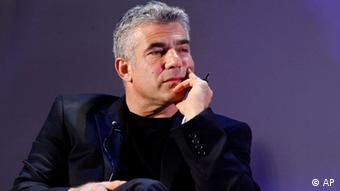 In this photo dated Dec. 22, 2010, Israeli journalist, author and TV-anchor Yair Lapid attends a conference in Tel Aviv. Lapid, one of Israel's most popular television personalities (Photo: Miriam Alster/AP)