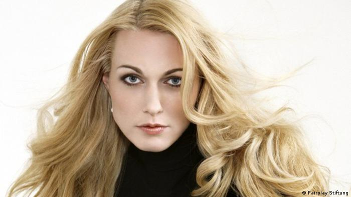 Photo of Katharina Wagner: highly stylized and made up, with flowing blonde tresses