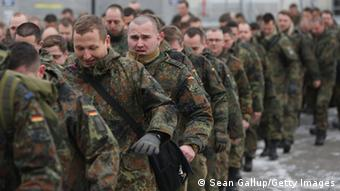 BERLIN, GERMANY - JANUARY 20: A contingent of approximately 240 soldiers of the German Bundeswehr prepare to board a plane for Turkey on January 20, 2013 in Berlin, Germany. German is committing two units of Patriot anti-missile systems to help defend Turkey from possible attack from Syria. (Photo by Sean Gallup/Getty Images)