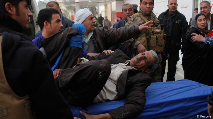 A man wounded by a suicide bomber in Tuz Khurmato city, is treated at a hospital in Kirkuk, 250 km (155 miles) north of Baghdad, January 23, 2013. A suicide bomber disguised as a mourner killed at least 22 people inside a Shi'ite Muslim mosque in the northern Iraqi city of Tuz Khurmato on Wednesday when he detonated his explosives in the middle of a crowded funeral ceremony. REUTERS/Ako Rasheed