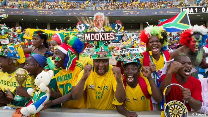 South African fans cheer as their team take on Angola during their African Nations Cup Group A soccer match at the Moses Mabhida stadium in Durban, January 23, 2013. REUTERS/Rogan Ward (SOUTH AFRICA - Tags: SPORT SOCCER)