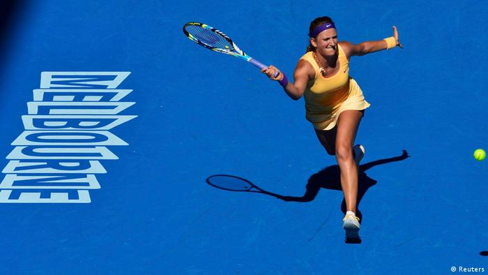 Victoria Azarenka of Belarus hits a return to Sloane Stephens of the U.S. during their women's singles semi-final match at the Australian Open tennis tournament in Melbourne January 24, 2013. REUTERS/Toby Melville (AUSTRALIA - Tags: SPORT TENNIS)
