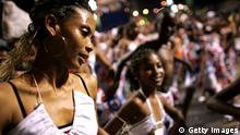 GettyImages 52240998 SALVADOR, BRAZIL- FEBRUARY 6: A woman dances through the streets during Carnival on February 6, 2005 in Salvador, Brazil. Centuries of slave trade with Central and West Africa has left 40 million people of African descent in Brazil, concentrated particularly in and around the city of Salvador on the northeast coast. The Carnival in Salvador, which lasts one week in the month of February, is one of the largest manifestations of Afro-Brazilian dance and culture in Brazil. From mid day to the early hours of the morning- floats carrying musicians, each followed by a contingent of dancers come from poor black neighborhoods to the center of the city forming a snake like parade that turns the city into one large rhythmic festival filled with joy, sensuality and revelry. (Photo by David Turnley/Getty Images)