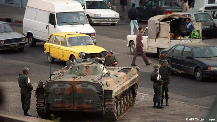 GettyImages 122164616 An armoured vehicle takes position in front of government buildings 12 January 1992 in Algiers the day after the resignation by Algerian President Chadli Bendjedid. (ABDELHAK SENNA/AFP/Getty Images)
