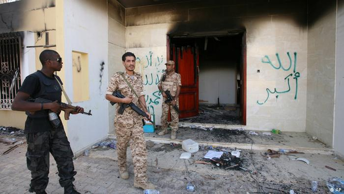 In this Sept. 14, 2012 file photo, Libyan military guards check one of the burnt out buildings at the U.S. Consulate in Benghazi, Libya