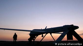A silhouette of a drone aircraft at an airstrip