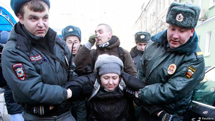 Interior Ministry officers detain gay rights activists for taking part in an unsanctioned protest near the Duma, Russia's lower house of Parliament, in Moscow January 25, 2013.