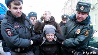 Interior Ministry officers detain gay rights activists for taking part in an unsanctioned protest near the Duma, Russia's lower house of Parliament, in Moscow January 25, 2013. Russia's parliament is due to hold its first reading on a homosexual propaganda law on Friday, which was earlier postponed. Russian lawmakers may adopt the bill that bans promotion of homosexual, lesbian, bisexual, and transgender practices among minors and imposes large administrative fines for spreading propaganda of this kind during concerts in particular, according to local media. REUTERS/Sergei Karpukhin (RUSSIA - Tags: POLITICS CIVIL UNREST SOCIETY CRIME LAW)