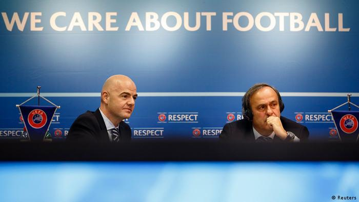 UEFA General Secretary Gianni Infantino (L) and UEFA President Michel Platini address a news conference after the first UEFA Executive Committee reunion of the year at the UEFA headquarters in Nyon January 25, 2013. REUTERS/Valentin Flauraud