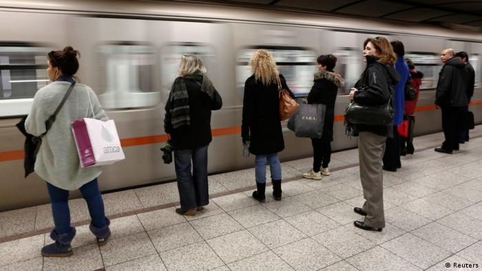 Passengers wait to board on a train at Syntagma metro station after the end of a nine-day strike in Athens January 25, 2013.