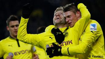 Borussia Dortmund's Jakub Blaszczykowski and Lukasz Piszczek (R) celebrate a goal against Nuremberg during the German Bundesliga first division soccer match in Dortmund January 25, 2013. REUTERS/Ina Fassbender (GERMANY - Tags: SPORT SOCCER) DFL RULES TO LIMIT THE ONLINE USAGE DURING MATCH TIME TO 15 PICTURES PER GAME. IMAGE SEQUENCES TO SIMULATE VIDEO IS NOT ALLOWED AT ANY TIME. FOR FURTHER QUERIES PLEASE CONTACT DFL DIRECTLY AT + 49 69 650050