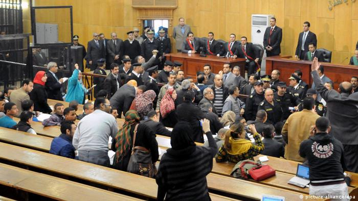 epa03556085 A general view shows judges and people and relatives of some of victims killed during the Port Said soccer game, as the court is about to release the verdict, at a courthouse in Cairo, Egypt, 26 January 2013. An Egyptian court sentenced 21 people to death on 26 January for their role in the country_s worst football tragedy last year, in which dozens were killed. Seventy-four people died in the Port Said stadium when riots broke out between rival fans of the hosts al-Masry and the visiting team al-Ahly following a Premier League match in February 2011. EPA/AHMED SADA