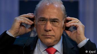 Mexican Angel Gurria, Secretary-General of the Organization for Economic Co-operation and Development (OECD) adjusts his headphone during a session at the 43rd Annual Meeting of the World Economic Forum, WEF, in Davos, Switzerland, Saturday, Jan. 26, 2013. (Foto:Anja Niedringhaus/AP/dapd)