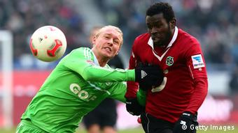 Mame Diouf (R) of Hanover and Simon Kjaer (L) of Wolfsburg battle for the ball