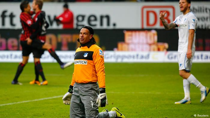 Goalkeeper Tim Wiese of TSG Hoffenheim reacts after Eintracht Frankfurt scored a goal during their German first division Bundesliga soccer match in Frankfurt, January 26, 2013. REUTERS/Kai Pfaffenbach (GERMANY - Tags: SPORT SOCCER)