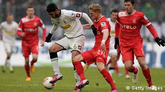 Tolga Cigerci (L) of Gladbach and J. van den Bergh (R) of Duesseldorf battle for the ball