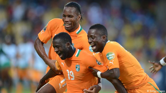 RUSTENBURG, SOUTH AFRICA - JANUARY 26, Yaya Toure (M) of Ivory Coast celebrates scoring a goal with Didier Drogba and Max Gradel during the 2013 African Cup of Nations match between Ivory Coast and Tunisia at Royal Bafokeng Stadium on January 26, 2013 in Rustenburg, South Africa. (Photo by Lefty Shivambu / Gallo Images/Getty Images)
